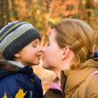 Mother kissing her 3 years old son — Stock Photo