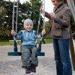 Stock Photo: Mother and son on swing