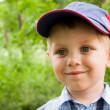 Boy in cap outdoor in spring — Stock Photo