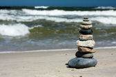 Ten pebbles stacked on beach — Stock Photo