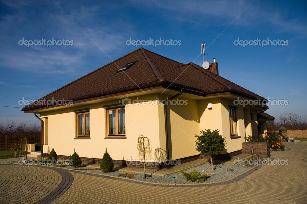 Single family small house over blue sky  Stock Photo #2044761