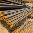 Rusty metal rods on ground — Stock Photo