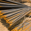 Rusty metal rods on ground - Stock Photo