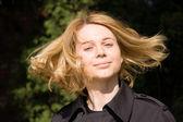 Woman moving hair outdoors — Stok fotoğraf