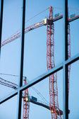 Construction cranes reflection — Stock Photo