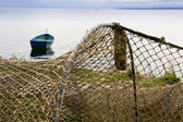 Fishing nets drying on shore — Stock Photo