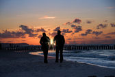 Silhouette of couple on beach — Stock Photo