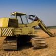 Stock Photo: Dirty yellow excavator