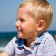 Small boy smiling on beach — Stock Photo #2527775