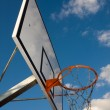 Basketball hoop over blue sky - Stock Photo