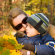 Mother and her son in autumn — Stock Photo