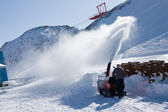 Worker remove snow with blower — Stock Photo