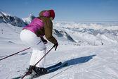 Woman downhill ski in apls — Stock Photo