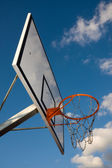 Basketball hoop over blue sky — Stock Photo