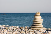 Ten white pebbles on beach — Stock Photo