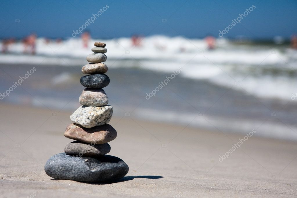 Ten differently colored and shaped pebbles stacked on a beach — Stock Photo #2527992