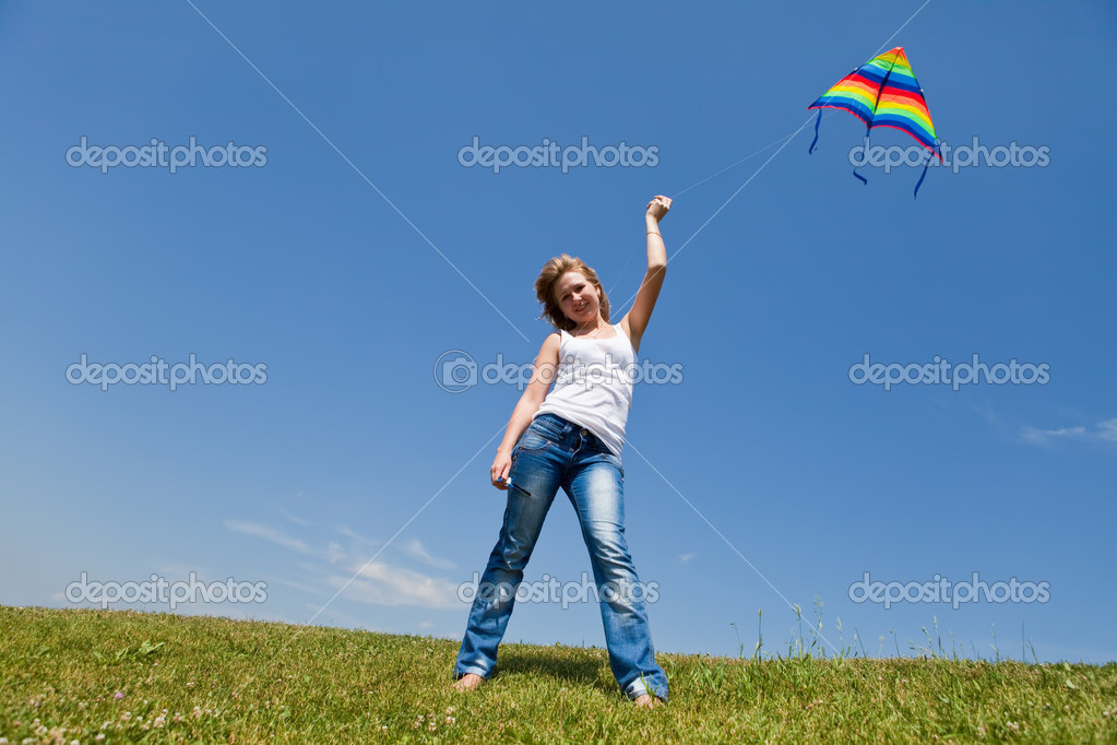 Beautiful girl with a kite in a hand — Stock Photo #1718911