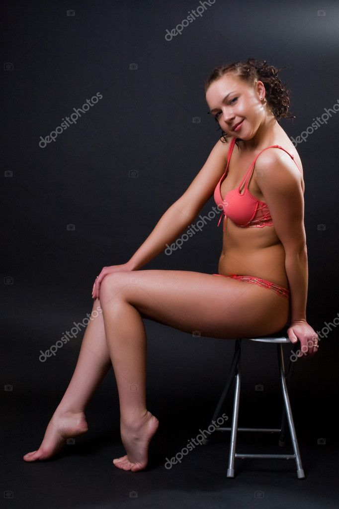 Beautiful girl in red bikini against a dark background  Stock Photo #1732685