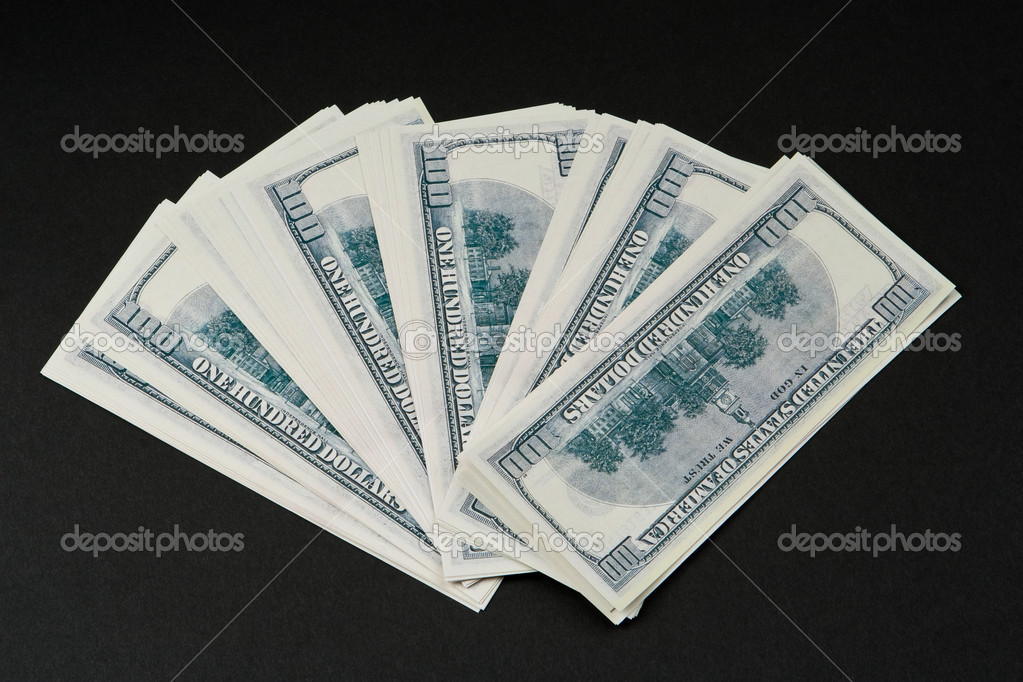 Pile of dollars against a dark background — Stock Photo #1737867