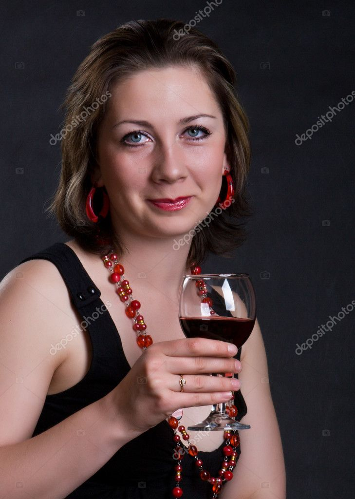 Nice girl with a glass of red wine on a dark background — Stock Photo #1835479
