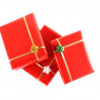 Three red gifts on white background — Stock Photo