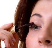 Young beautiful woman applying make up — Stock Photo
