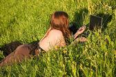 Girl,grass,laptop — Stock Photo
