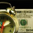 Stock Photo: Alarm clock and money 01