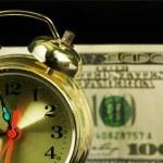 Alarm clock and money 01 — Stock Photo