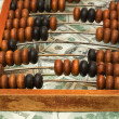 Stock Photo: Old abacus on dollars