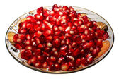 Pomegranate grains on a plate. — Stock Photo