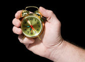 Alarm clock in a hand — Stock Photo