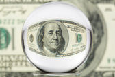 Glass sphere, dollar, four — Stock Photo