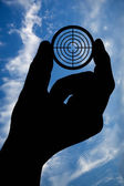 Hand with target and sky — Stock Photo