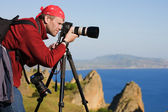 Photographer,tripod,sea,rocks — Stock Photo