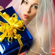 Surprised bride with present — Stock Photo #1787691