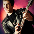 Royalty-Free Stock Photo: Excited young man playing guitar