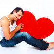 Man with a heart — Stock Photo