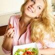 Pretty girl eating salad - Stock Photo