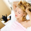 Blond girl relaxing in bed — Stock Photo