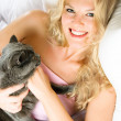 Royalty-Free Stock Photo: Happy girl with her cat