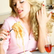Girl eating spaghetti — Stock Photo #1799217