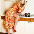 Pretty housewife cooking dinner — Stok fotoğraf #1799245
