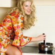 Girl cooking dinner — Stock Photo