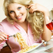 Girl eating spaghetti — Stock Photo