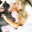 Stock Photo: Pretty womwith her cat