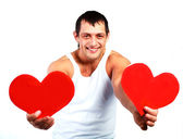 Young man with two hearts — Stock Photo