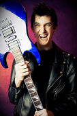 Excited man with a guitar — Stock Photo