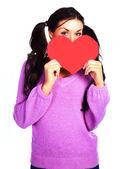 Flicka med en alla hjärtans-kort — Stockfoto