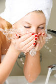 Girl washing her face — Stock Photo